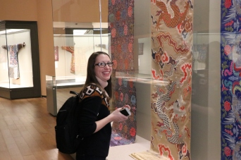 "Carrie Hertz enjoys the textile portion of the ""Tsinghua Treasures: Exhibition of Tsinghua University Art Museum Collection."" December 8, 2017. Photograph by Jon Kay."