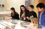 "Scenes from the textile portion of the ""Tsinghua Treasures: Exhibition of Tsinghua University Art Museum Collection."" (L-R) Carrie Hertz, Wang Ying, and Peter Wen. Photograph by Jon Kay."