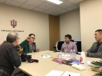 China-related projects being discussed at the Indiana University China Gateway office. (L-R) Jon Kay, Jason Jackson, Peter Wen, and Steven Yin. December 8, 2017. Photograph by Carrie Hertz.