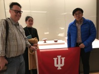 "Posing with an ""IU Red"" bowl in the ceramics portion of the ""Tsinghua Treasures: Exhibition of Tsinghua University Art Museum Collection."" December 8, 2017. (L-R) Jason Jackson, Ge Xiuzhi, and Peter Wen. Photograph by Carrie Hertz."