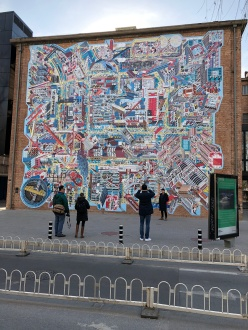 """The big new (to us) mural in 798 is a map of the district. It is a magnet for """"I was there"""" photography. December 9, 2017. Photograph by Kurt Dewhurst."""