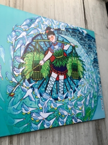 A farmer painting-style image on a street sign in the Beijing neighborhood near the Temple of Heaven. December 8, 2017. Photograph by Jason Baird Jackson.