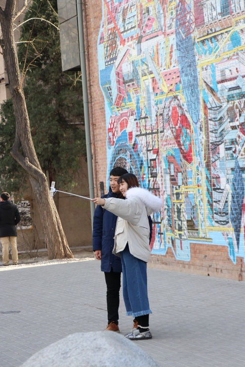 The selfie stick is still an essential item in 798. December 9, 2017. Photograph by Jon Kay.