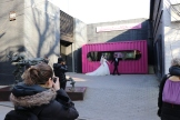 Jon photographs Carrie photographing the engaged or newlywed couple in 798. December 9, 2017. Photograph by Jon Kay. Carrie's Ph.D. dissertation is on the classic white American wedding dress, giving this scene extra interest. December 9, 2017. Photograph by Jon Kay.