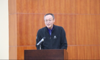 AMGX Director Wang Wei at the collaboration ceremony. December 12, 2017. Photograph by Jon Kay.