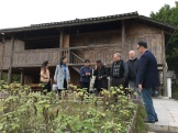 Scenes from the first day of the Workshop on Ethnographic Methods in Museum Folklore and Ethnology held at the Anthropological Museum of Guangxi, Nanning. Here workshop participants visit the museum's ethnobotanical garden and discuss local dye plants. December 11, 2017. Photograph by Marsha MacDowell.