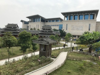 "Scenes from the first day of the Workshop on Ethnographic Methods in Museum Folklore and Ethnology held at the Anthropological Museum of Guangxi, Nanning. This image shows the back of the museum as seen from the ""Miao House"" located on the museum grounds. December 11, 2017. Photograph by Carrie Hertz."