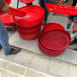 Skuomorphs on market day in Lihu town! These plastic trays and sifters attempt to preserve the appearance of their basketry counterparts while filling the same functions. While cheaper, we were told that they do not hold up as well as bamboo, especially when exposed to light. (A familiar problem also known to museum workers.) December 16, 2017. Photograph by Jason Baird Jackson.